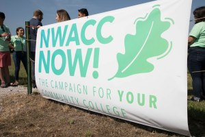 Photo of sign that reads NWACC Now!, the name for new capital campaign