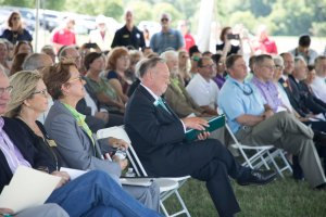 Photo of people sitting in chairs at the college's groundbreaking ceremony in Springdale